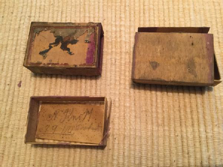 Matchboxes found in church roof on soffit